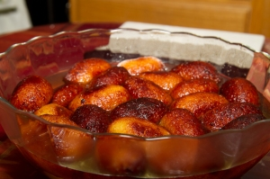 Allow the gulab jamun to stand at room temperature while the syrup is absorbed.